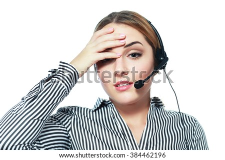 Tired call center operator touching her head feel crazy - stock photo