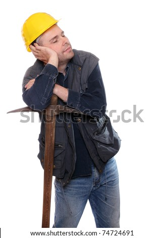 Tired construction worker asleep on his pick axe.