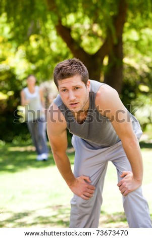 Tired couple in the park - stock photo