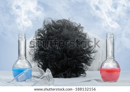 Tired crazy scientist in laboratory, failed experiment - stock photo