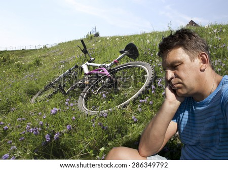 Tired cyclist. - stock photo