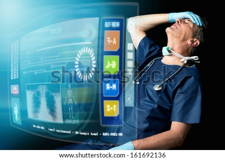 Tired doctor in uniform in a dark background with screens