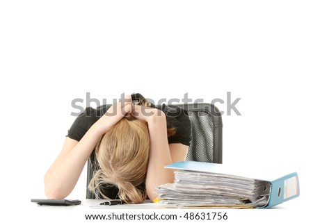 Tired female executive filling out tax forms while sitting at her desk. Isolated on white - stock photo