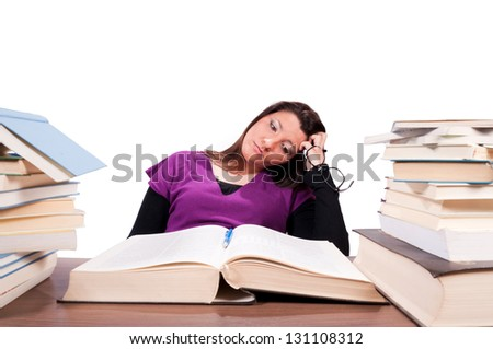 Tired female student have a problems with learning isolated on white. Selective focus on the female - stock photo