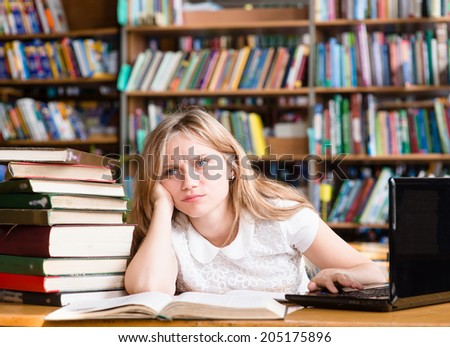 tired female student n library - stock photo