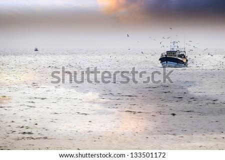Tired fishing fleet getting back, France near the Atlantic ocean - stock photo