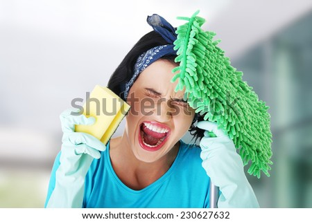 Tired frustrated and exhausted cleaning woman screaming - stock photo