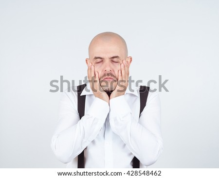 Tired frustrated man holding his hands on his face. Negative emotions. - stock photo