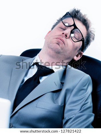 tired funny portrait of businessman sleeping at the office - stock photo