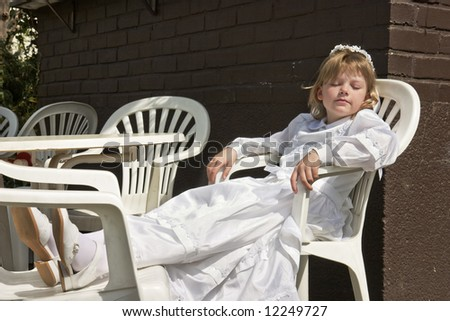 Tired girl at her first communion - stock photo