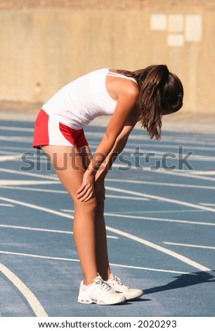 Tired girl on a blue racetrack - stock photo