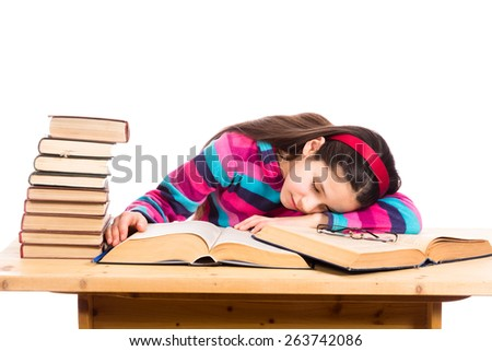 tired girl sleeping on the pile of old books, isolated on white - stock photo