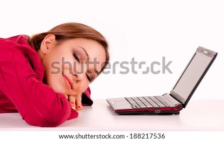 tired girl with laptop, white background - stock photo