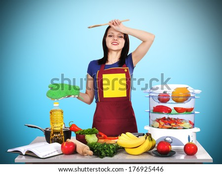 tired housewife standing on kitchen - stock photo