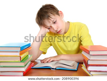 Tired Kid at the School Desk with a Books Isolated on the white background - stock photo