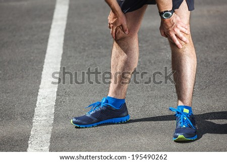 Tired male runner resting after training. - stock photo