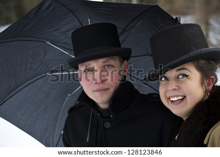Tired man and happy woman under common umbrella