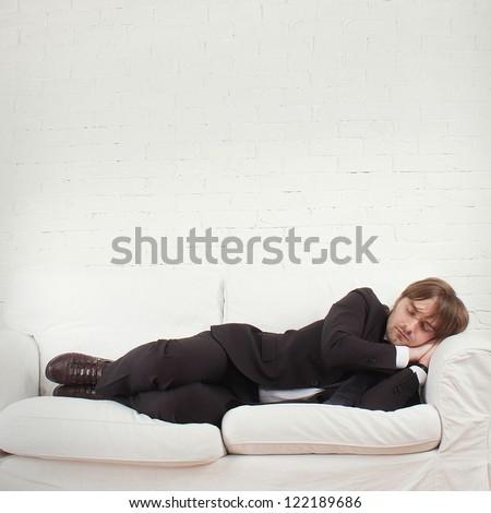 tired man sleeps - stock photo