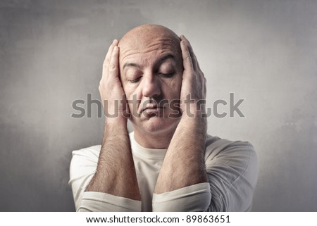Tired man with the head in his hands - stock photo