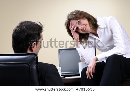 tired manager talking with her partner - stock photo