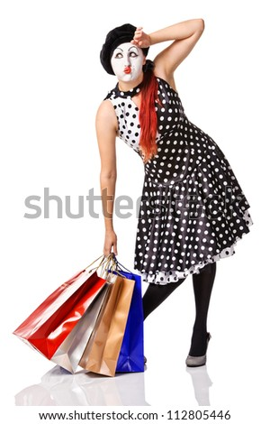 tired mime in spotty dress holding shopping bags - stock photo