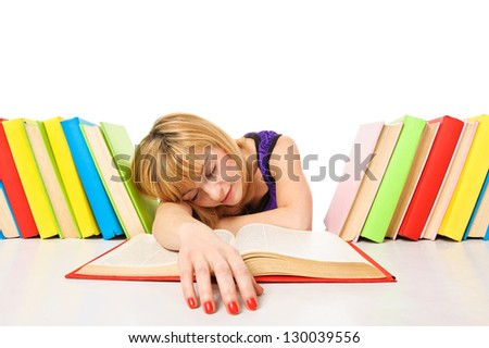 Tired of studies, young Woman is sleeping on her desk with books. Isolated
