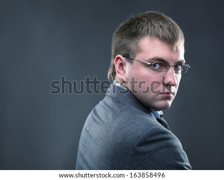 Tired office worker in a suit staring pensively