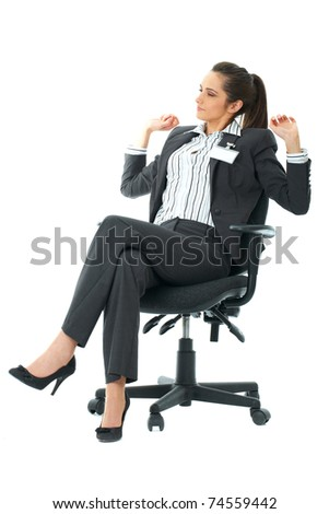 tired office worker sits in her chair and stretch her arms, isolated on white - stock photo