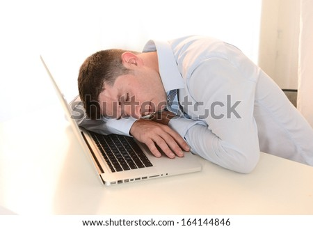 Tired Overworked Businessman sleeping over keyboard at Work  - stock photo