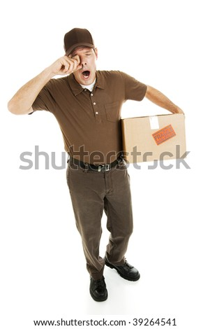 Tired, overworked delivery man rubbing his eyes and yawning.  Full body isolated. - stock photo