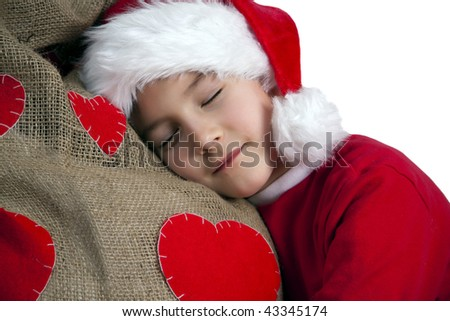 Tired santa boy - stock photo