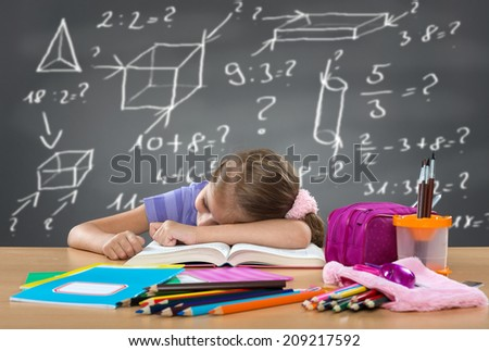 Tired school girl sleeping on the bench, behind heavy duties on the board