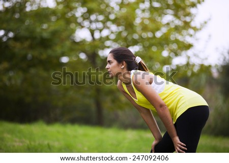 Tired sport woman resting after running - stock photo