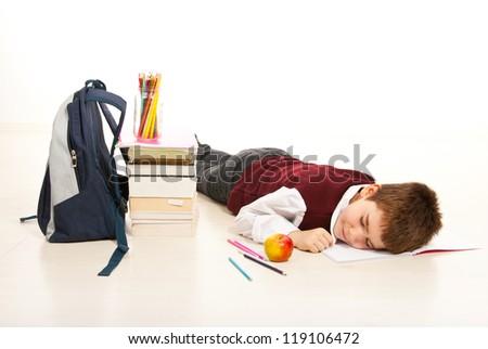 Tired student boy asleep while doing homework - stock photo