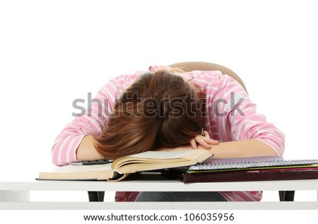 Tired student girl is sleeping on books and files, on the desk. Isolated on the white background. - stock photo