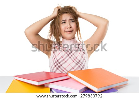 Tired student girl with books isolated on white background - stock photo