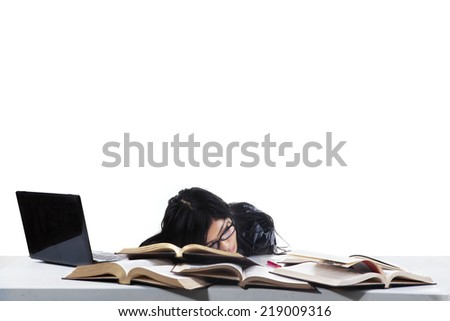 Tired student girl with glasses sleeping on the books. isolated on white background - stock photo