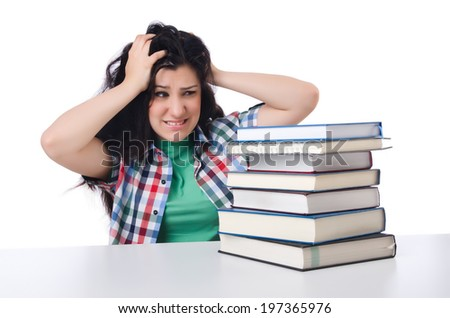 Tired student with textbooks on white - stock photo