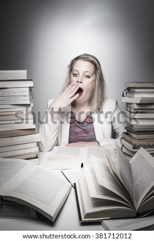 Tired student young woman - Educational theme - Exhausted pupil - Stressed student studying between a pile of books - Hard work - Frustrated - Learning and questioning - Learning concept - Solution - stock photo