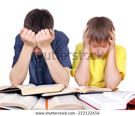 Tired Teenager and Kid at the School Desk on the white background - stock photo