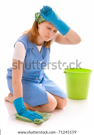 tired woman cleaning the floor with a rag - stock photo