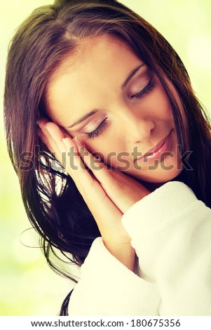 Tired woman in white bathtube  - stock photo