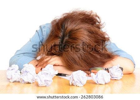 Tired woman thinking and writing paper - stock photo