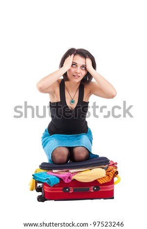 Tired woman whit her suitcase, isolated on white - stock photo
