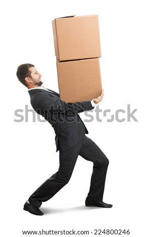 tired young businessman carrying two heavy boxes. isolated on white background - stock photo