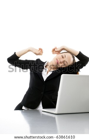 tired young businesswoman with laptop on white background studio - stock photo