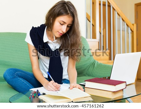 Tired young girl at home behind her laptop