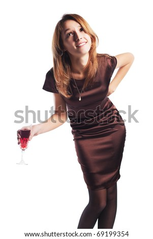 Tired young woman with a red wine. - stock photo