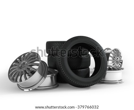 Tires and wheels on the white background. - stock photo