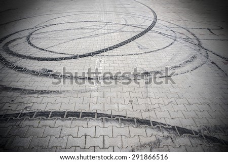 Tires burning out tracks - stock photo